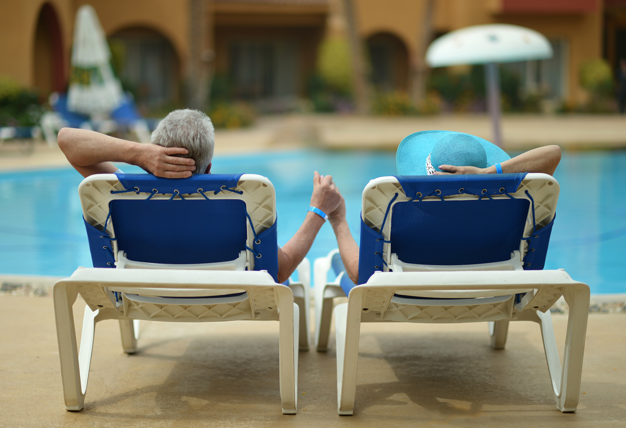 Image of a couple enjoying the pool at Bay Bridge Cove - One of the Best Places to Retire in Maryland