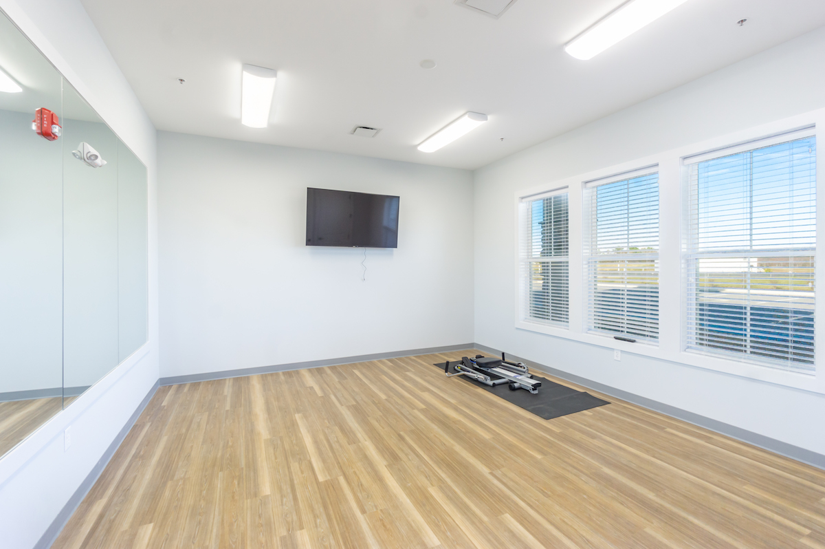 yoga room with mirrors.