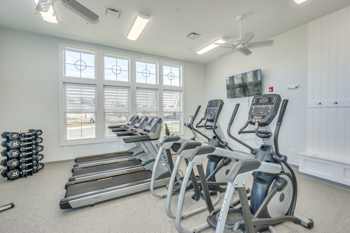 Image of the fitness center inside the Bay Bride Cove Community Clubhouse