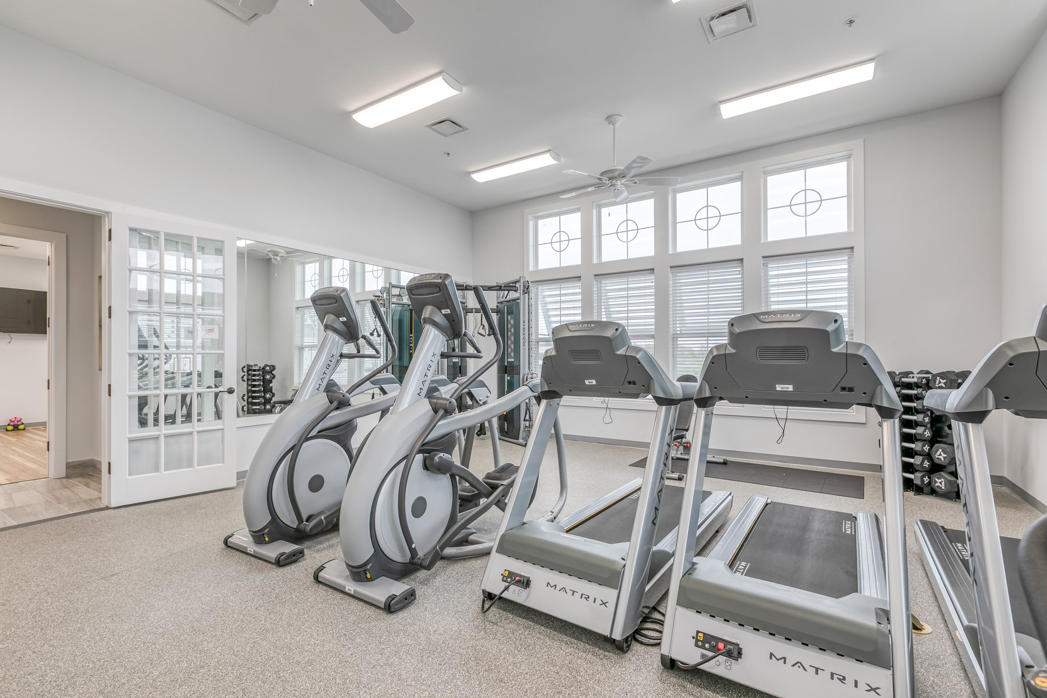 Image of the fitness center with treadmills inside the Bay Bride Cove Community