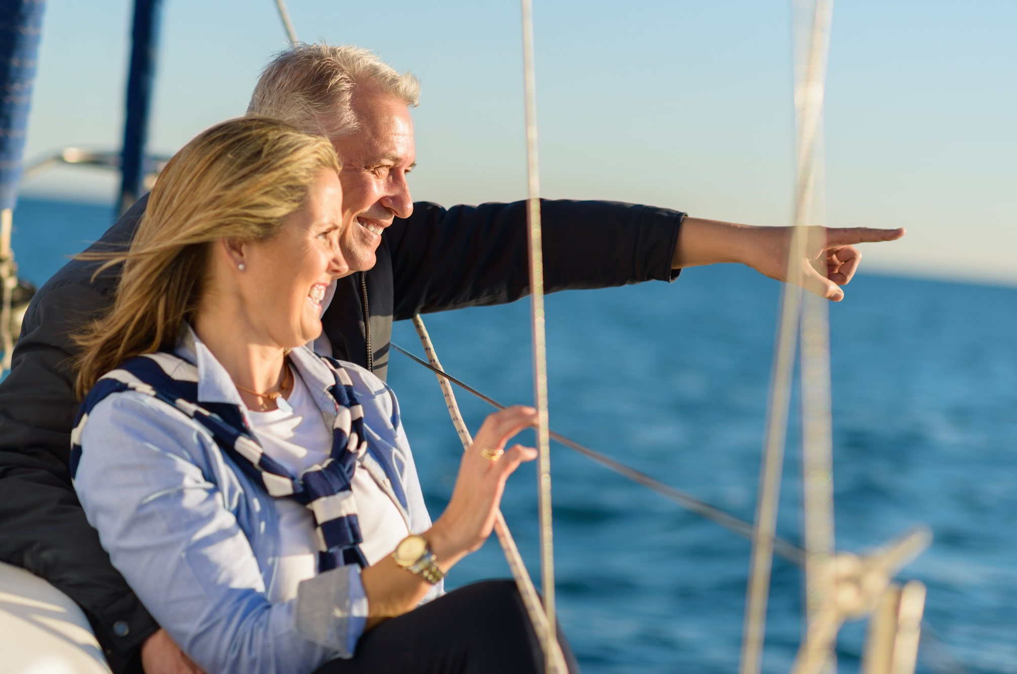 Couple smiling on a boat.